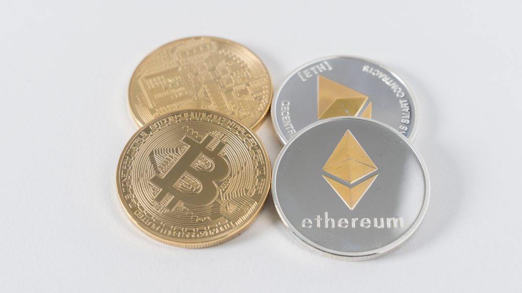 four round silver-colored and gold-colored Bitcoins