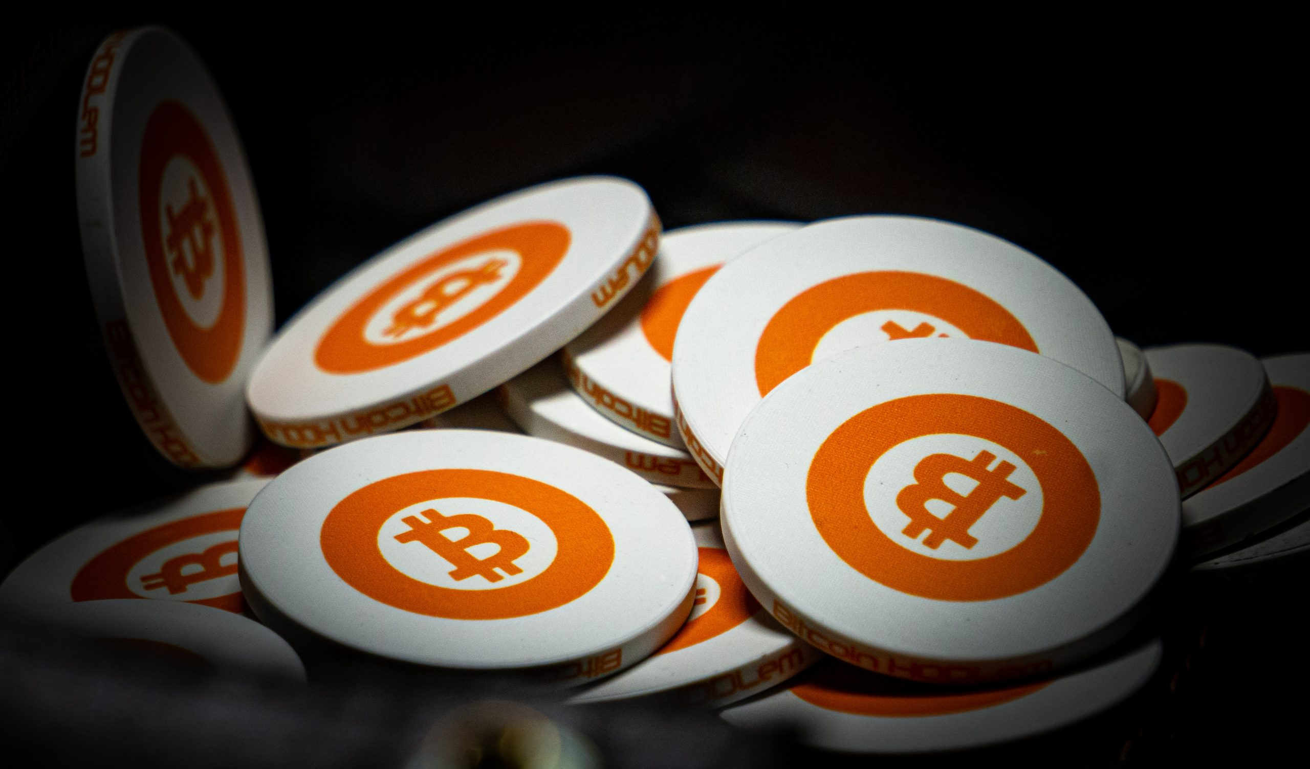 white and orange bitcoin chips